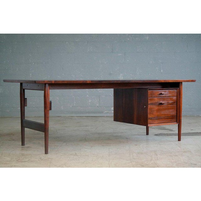 Magnificent large Danish midcentury executive desk in rosewood designed by Arne Vodder in the 1950's and manufactured by...