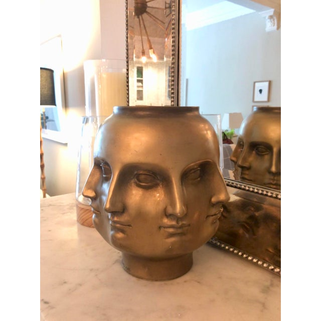 Beautiful abstract gold perpetual faces vase made of resin in the style of Italian artist Pietro Fornasseti. A classic...