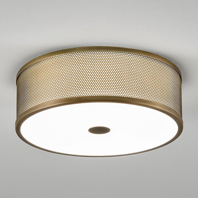Golden bronze metal work light with a matt opal acrylic diffuser. Includes a dimmable integral LED light source to produce...