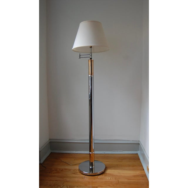 Incredibly chic 1970s column floor lamp features nice proportions and clean lines. The chrome body is accented with brass...