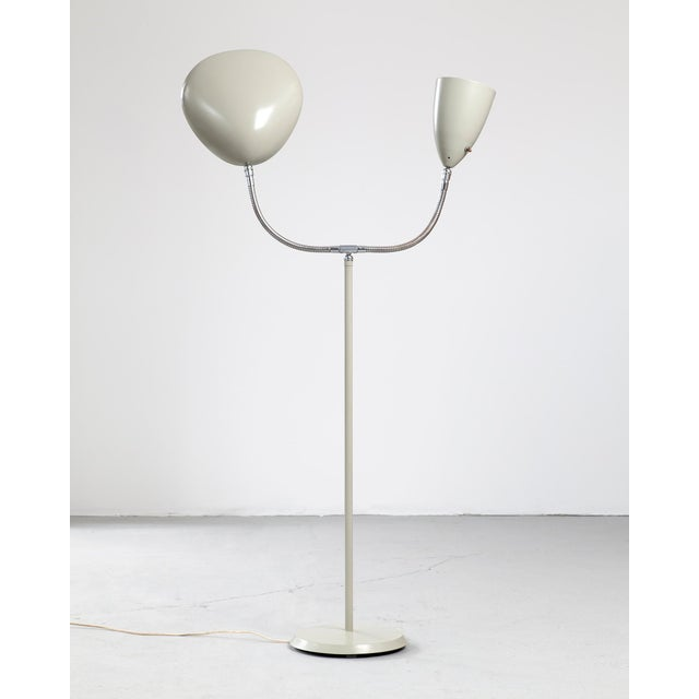 "Floor lamp in enameled aluminum on a chrome-plated steel base with one cone shade and one ""Cobra"" shade. Designed by Greta..."
