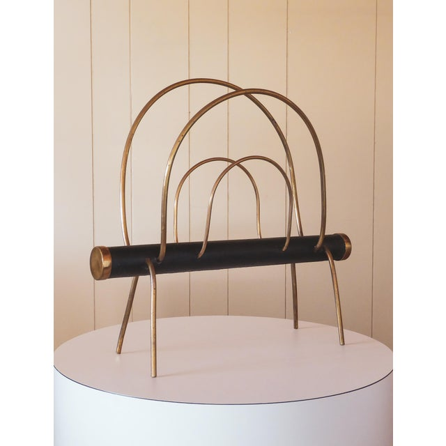 A elegantly simple magazine rack characteristic of Viennese modern design in the 1950's. The piece implements the same...