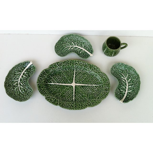 Here is a 5 piece set of vintage Majolica Bordallo Pinheiro green cabbage leaf serving dishes. Includes platter, dishes,...