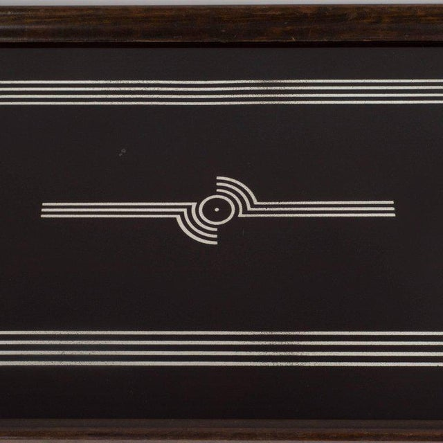 This elegant tray features glass hand-painted geometric streamlined designs in sterling silver over an ebonized walnut...