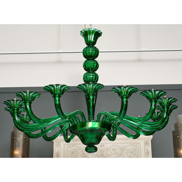 Stunning emerald green Murano glass chandelier made of hand-blown glass and featuring 16 arms. This exquisite fixture has...