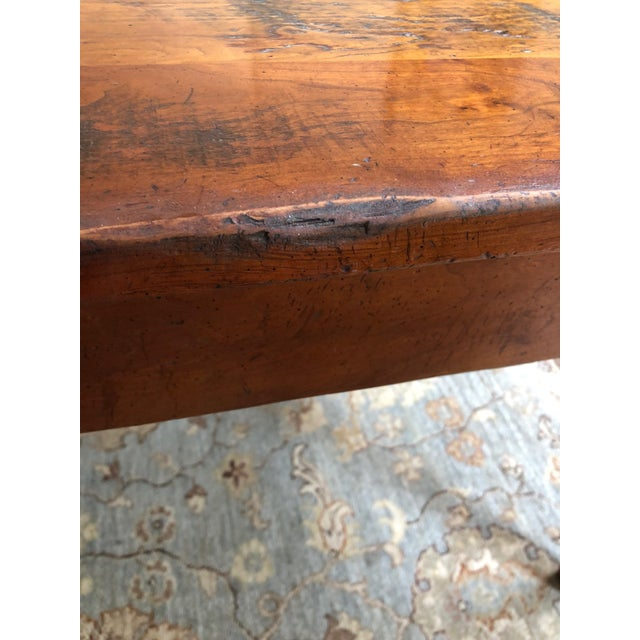 Gorgeous handcrafted farm table in rich warm browns and black, having lots of character in the grain and distressed...