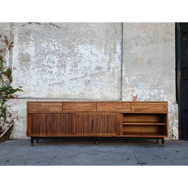 Sleek and sophisticated, this modern credenza is in excellent condition and ready to be put to good use! Meeting all of...