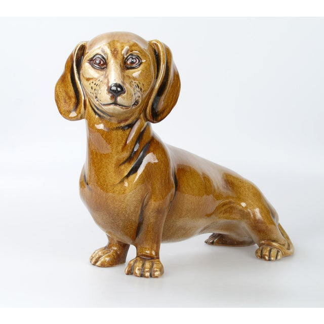 Ceramic brown dog finished in a high glaze. Very natural looking. Made in Italy.
