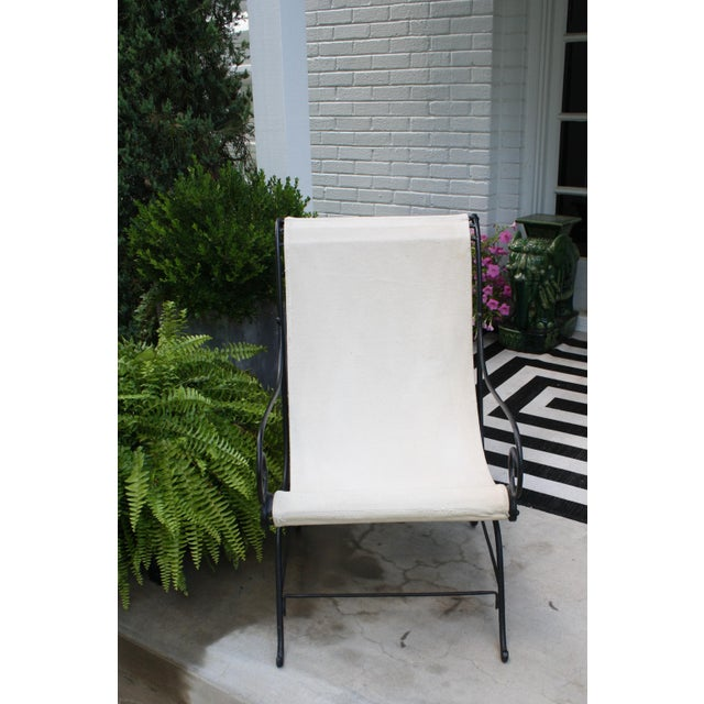 This wrought iron sling chair has great lines and it could be used indoors or out. There are screws which make it easy to...