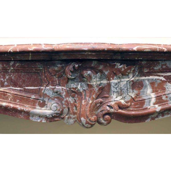 19th century Louis XV hand carved mantel. This is a later example of rouge royale, and is a little more red than brown. It...