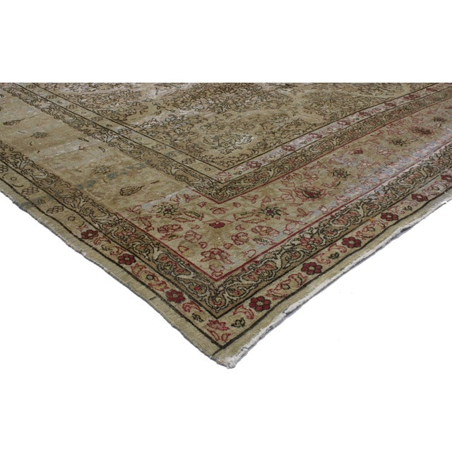 72742 Distressed Antique Persian Kermanshah Area Rug with Romantic Industrial Style 09'05 x 13'02. This hand-knotted wool...