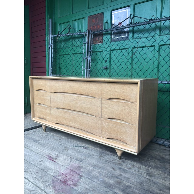 This mid century long dresser by Kent Coffey is from the Elegante series and features solid wood construction, original...