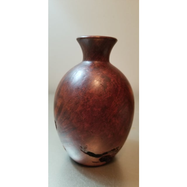 Beautiful burl wood bud vase - there is not an insert so not viable to hold water.