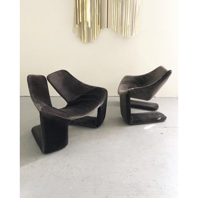 These rare lounge chairs feature a sculptural steel frame wrapped in crushed grey velvet upholstery. The lounge chair was...