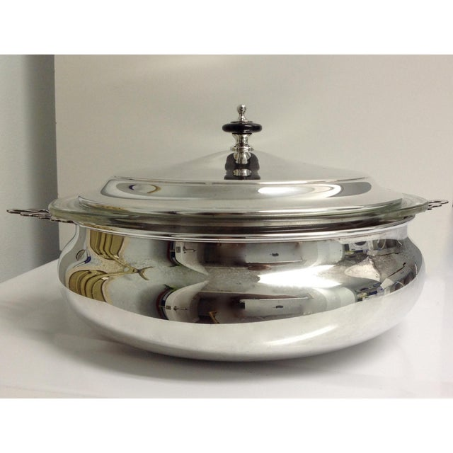 1970s; Silver plate lidded, round server bowl, or chaping dish, with pierced Celtic or English style handles. Comes with...