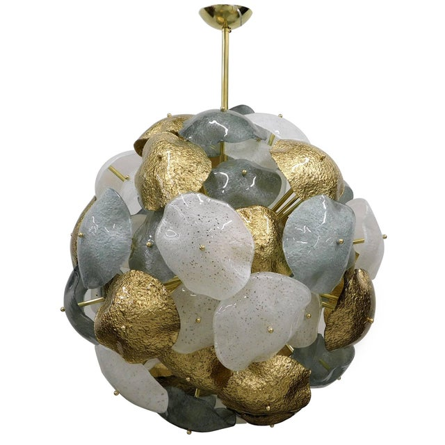 Italian chandelier with hand blown white, teal, and gold Murano glass shades, mounted on a spherical brass frame /...