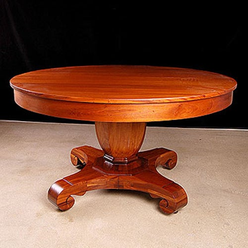 American Empire style round mahogany pedestal dining table made by Brown & Simonds, Boston. Table has telescope expansion...