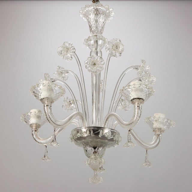 Circa 1900 Venetian clear glass chandelier with several hand crafted large daffodils and five candle style lights. New...