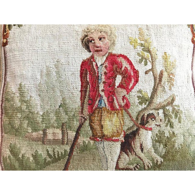 18th Aubusson tapestry of a man with a spaniel in the country framed with antique champagne gold metallic galon on...