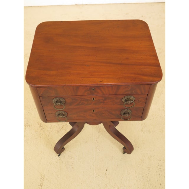 American antique Duncan Phyfe mahogany serving work table. Features dovetailed drawer construction and original brass...