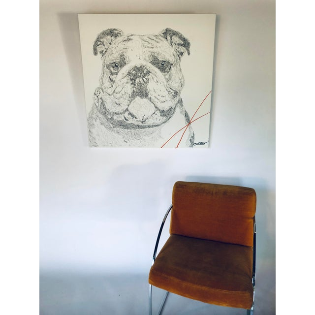 Original piece by Austin-based artist Carlos E. Ortiz. This English bulldog is created with ballpoint pen and accented...