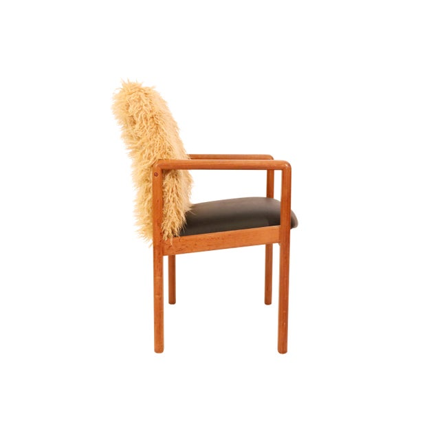 Mid-Century curated danish teak armchair with Mongolian faux fur light brown shade and vinyl black on the seat. Sturdy &...