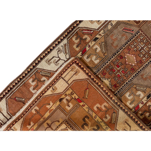 Beautiful Vintage Persian Rug, with a brown field, tan and ivory accents in allover floral medallion design. This rug...