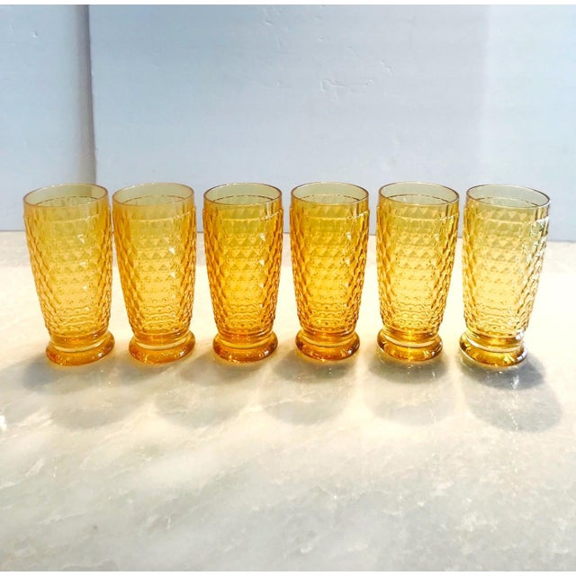 Set of seven luxury crystal highball barware glasses from Villeroy & Boch's Boston series. The glasses are comprised of...