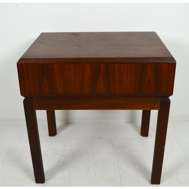 A vintage Founders Furniture Co. mid century walnut nightstand. Made in the 1960s. Very neat side table. Solid walnut,...