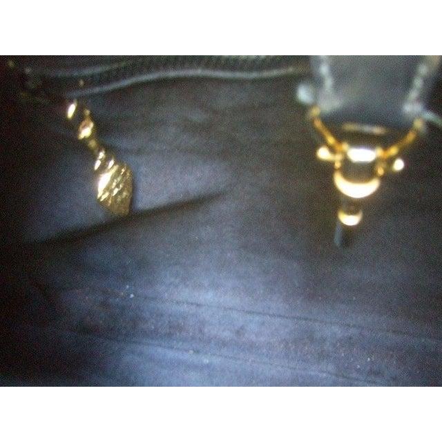 "GUCCI Italian ebony leather Jackie ""O"" versatile handbag / shoulder bag c 1970s The iconic Gucci black leather handbag..."