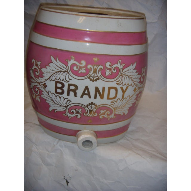 A beautiful old ornate porcelain Brandy dispenser from an English pub. No spigot, some damage at spigot's place.