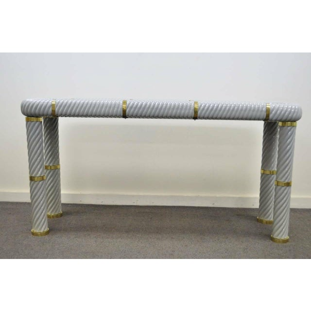 Remarkable grey solid porcelain spiral form hall or sofa table in the Hollywood Regency taste by Tommaso Barbi. This...