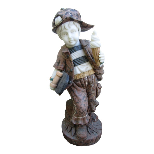 Granite Statue of a Boy Holding a Skateboard For Sale
