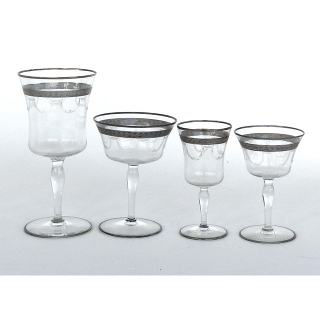 Offered for sale is a set of 28 Art Deco 1930's to 1940's stemware glasses. Each glass has a silver rim on the lip and...