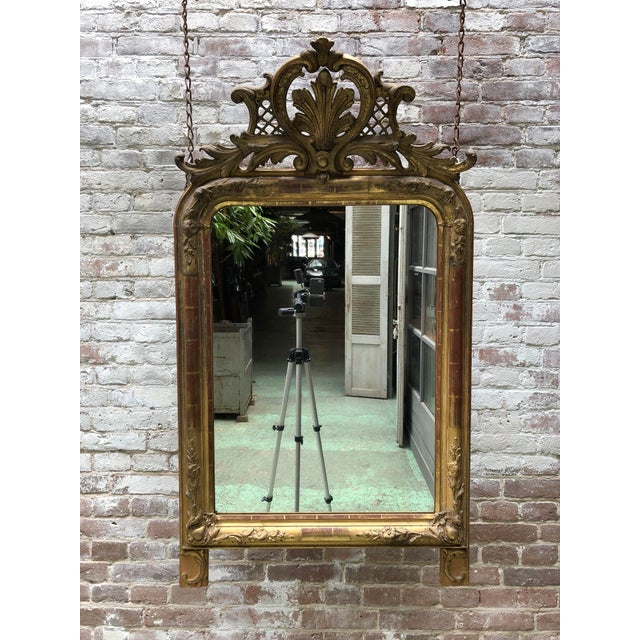 This 19th Century Mirror is adorned with floral and foliate patterns with a shell as main motif in the crest. Style Louis...