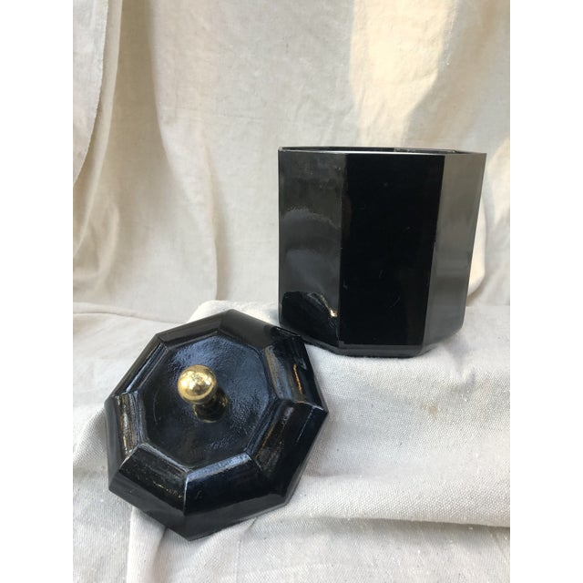 Shiny black lacquer octagonal ice bucket with gold/brass knob top & white inner ice bucket, made from plastic. By Nancy...