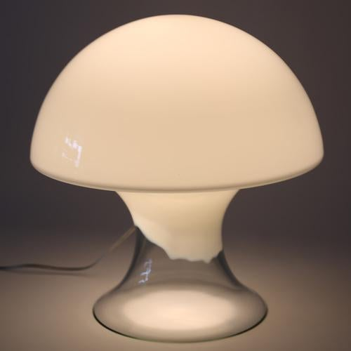 Whimsical mushroom-form table lamp with a combination of clear and white glass. Illuminated by a single standard-base...