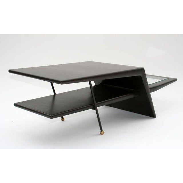 Amazing coffee or side table - a dark stained tapered wood slab intersects a bent tapered wood form and is supported by...