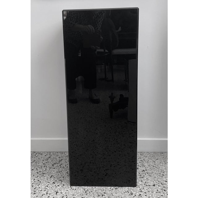 This stylish and substantial black Lucite pedestal dates to the 1990s.