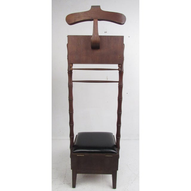 This beautiful vintage valet chair features a thick cushioned seat that opens up to unveil a large storage space. An...