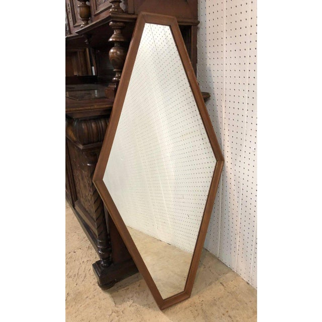 Pair of Mid-Century Modern, walnut framed diamond mirrors.