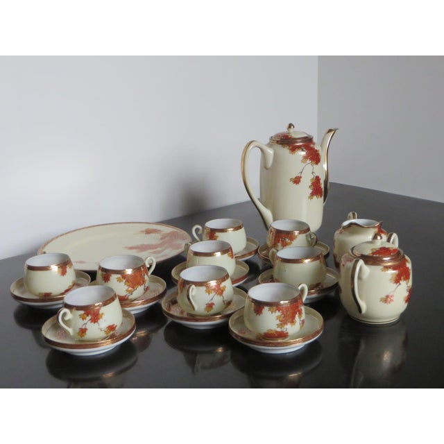 This is a porcelain Chinese or Japanese set of 9 espresso cups & saucers, 1 dessert plate, coffee pot, sugar bowl &...