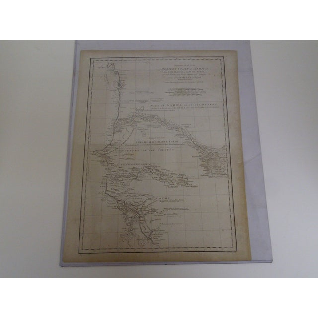 """Here is a circa 1788 vintage map of the western coast of Africa. Titled, """"From Cape Blanco To Cape De Verga"""". Engraved in..."""