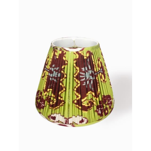Handmade in the USA. Hand-dyed and handwoven ikat fabric. White lining and brass washer. All Slightly East lampshades are...