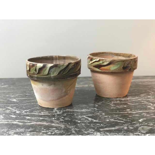 Set of four decorated and glazed rim pots from 1960s England. Can be individually sold.