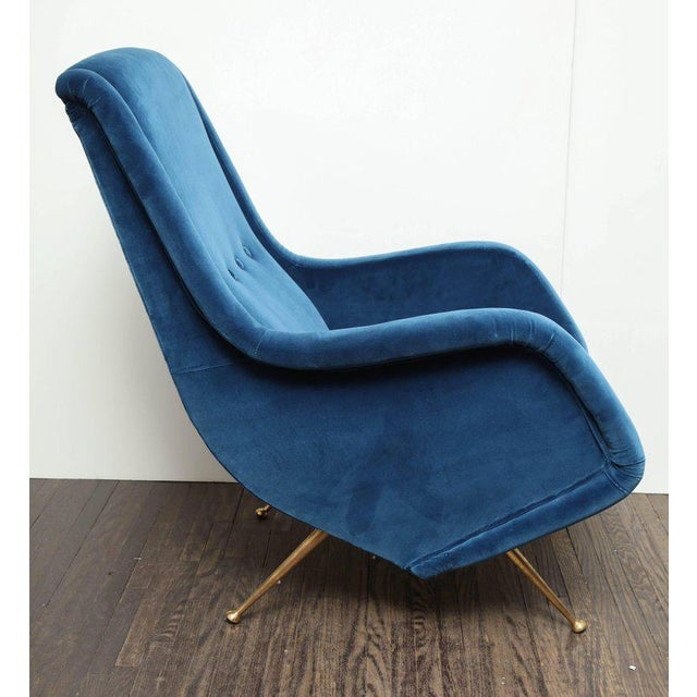 Pair of Parisi Vintage Italian club chairs upholstered in teal blue velvet.
