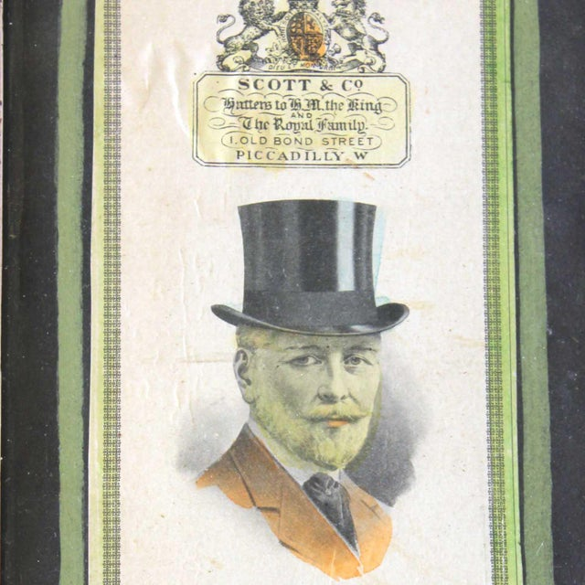 """A framed Scott & Co. Ad of """"The Silk Hat""""."""