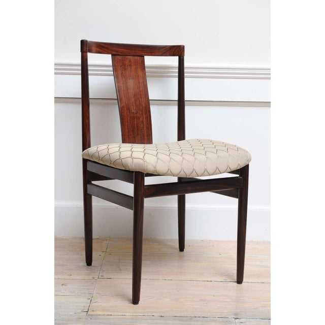 Pair of solid rosewood side or office chairs, reupholstered seat, circa 1950. English, Mid-Century Modern. Elegant and...