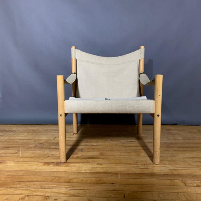 Simplicity of design. Oak frame Safari Chair with reinforced canvas sling seating, arm attached with metal toggles....