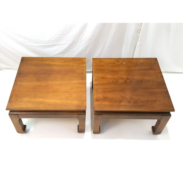 A pair of vintage ming style end tables featuring a simple elegant design and solid hardwood with maple veneer. These have...